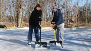 Joel Conybear, right, chair of the Philipstown Winter Carnival, and John Maasik, chair of the Philipstown Recreation Commission, donned their skates to shovel the ice at the new outdoor skating rink at the Claudio Marzollo Community Center in Garrison. (Photo by M. Turton)