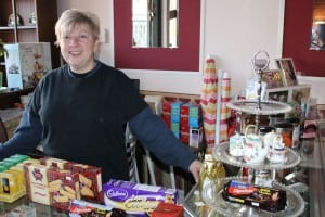 Shirley Wenlock-Hot behind a counter laden with British goodies.  (Photo by A. Rooney)