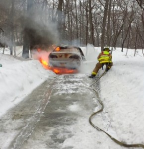 A Garrison firefighter controls a vehicle fire Feb. 19. Photo by Joseph Mercurio