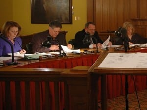 Legislators, from left, Barbara Scuccimarra, Sam Oliverio, Louis Tartaro, and Ginny Nacerino study materials and await colleagues prior to the March 4 Putnam County Legislature meeting. (Photo by L.S. Armstrong)