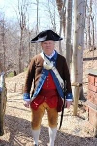 RetiredArmyCol.JamesJohnson,dressedinperiodcostumefortheribbon-cuttingceremony.