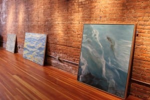 Two Fredericka Foster paintings waiting to be hung, just prior to the opening of Water Way. (Photo by A. Rooney)