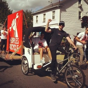 Peoples Bicycle proprietor Jon Miles and his pedi-cab. Spirit of Beacon Day Parade, 2012. (Photo by Jennifer Glennon König)