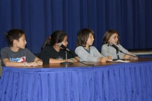 At a recent Garrison GEMS assembly, fifth graders, from left, Saja Digiovanni, Rachel Iazicoli, John Vogel and Sophie Stark held a forum about bus safety and answered questions from elementary students.