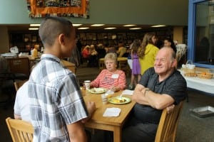 Terry Ridpath regales a sixth grader with tales of the school in the late 50s and early 60s.