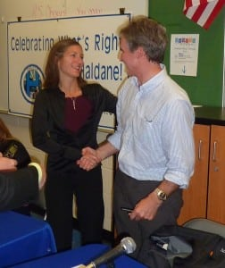 Peter Henderson accepts congratulations from Trustee Jennifer Daly after the news of his re-election to the Haldane Board of Education. (Photo by P. Doan)