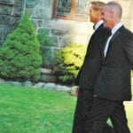 Randy Florke, left, and Sean Patrick Maloney cross the church lawn on their first, unofficial exit from the church after the wedding. Photo by L.S. Armstrong
