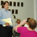 As a friend records the moment, Russ Cusick tells the Town Board of his storm-water concerns. Photo by L.S. Armstrong