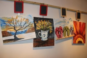 Art works created at eat-Paint-love, on display in the rear of the space. (Photo by A. Rooney)