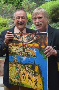 After being inducted into the Hall of Fame, George Stevenson, right, presented his friend, former teammate and fellow Vietnam vet Pat Kelliher, with one of his paintings.  Photo by M. Turton