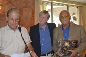 Bill DiCastro, left, and Lou Amoroso, right, presented George Stevenson with two plaques, marking his induction into the Fast Pitch Softball Hall of Fame.