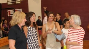 Parents of students from Garrison turned out with school spirit at the Freshman and New Student Orientation Aug. 27 at James I. O'Neill High School. From left, Chrissy Colasurdo, Valerie Young, Lori Mayo and Melissa Green.