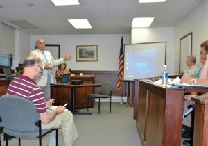 At the Putnam County Legislature's Physical Services Committee meeting, Vinny Tamagna presents the concept for use of space at a redeveloped Butterfield complex. (Photo by L.S. Armstrong)