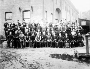 In the latter 19th century, WPF workers gather for a group photo by the machine shop. Photo courtesy of the Putnam History Museum
