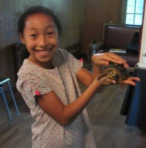 A delighted attendee holds a turtle during the first World Wildlife program.