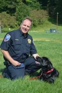 DetectiveJohnPetersandDaisy—Aworkingarsondog,DaisyisalsothePeters'familydog.