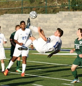 Aidan Draper defies gravity in varsity boys soccer's 2-1 win over Brewster on Sept. 15 at home. Goals were scored by Tucker Hine and Draper.