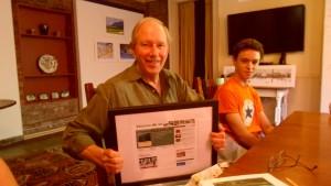Stewart receiving a framed memento of the website Philipstown.info