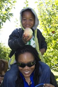 Jaden Myles Council of Queens was able to reach a big one at Fishkill Farms with the help of his mother Ebonie Council (Photo by Kevin E. Foley)