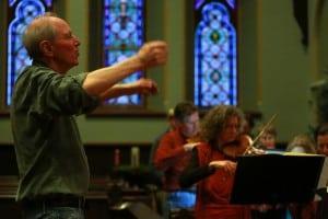 Gordon Stewart conducting a rehearsal in 2013