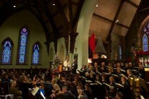 Rachel Evans, concertmaster, leading musicians and singers in The Hallelujah Chorus