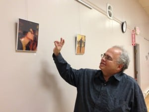 Photographer Markie Baylash gives a commentary of the images on display in the exhibition of his work at the Howland Library (Photo by A. Rooney)