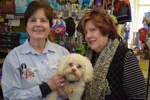 Mary Jane Nagel, left, and her partner Susan Elliot-Nagel with Buster, owners of Reigning Dogs and Cats Too, which will close April 1