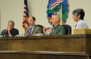 Councilor John Van Tassel (second from right) makes a point as Councilor Dave Merandy (left), Supervisor Richard Shea (second from left) and Town Clerk Tina Merando listen.