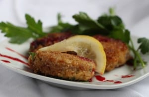 Crab cakes drizzled with beet sauce (Photo by M.A. Ebner)