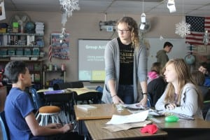 Peer mentor and Haldane 11th-grader Addie Westerhuis, standing, facilitates a lesson on bullying and friendships with Ellis Osterfeld, left, and Genna Sposet.