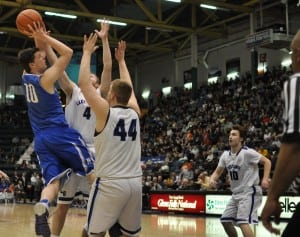 Haldane's Garret Quigley goes up and over defense in the third quarter of the March 20 final four game.