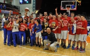 Haldane girls and boys celebrate Section 1 Class C Championships with girls' coach Tyrone Searight