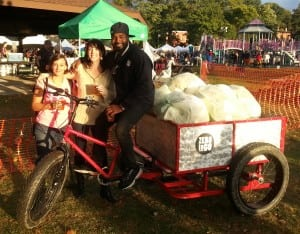 Zero to Go's Sarah Womer, left, and Ali T. Muhammad, right, catch up with a friend while collecting compostable materials at the Hudson Hop & Harvest Festival in Peekskill in October 2014.