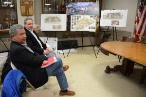 Framed by drawings from their project, Butterfield developer Paul Guillaro, left, with members of his redevelopment team, Matt Moran and Ray Sullivan, await the start of the public hearing.