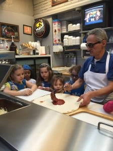 Mike Procopio of Cold Spring Pizza demonstrates the pie craft for the girls (photo provided)