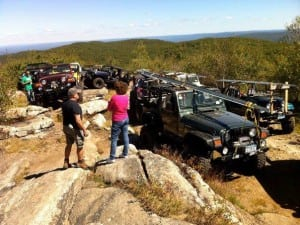 Members of local Jeep clubs help with the restoration of the Beacon Fire Tower in 2013.