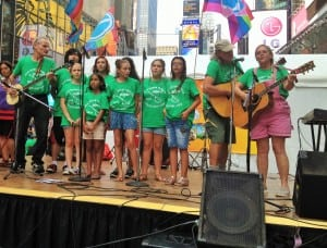 The Rivertown Kids, along with music director Travis Jeffrey, perform at the 2014 Eco-Fest in New York City.  (Photo by Tery Udell)