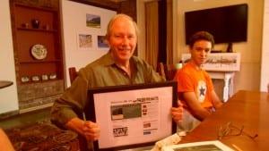 Stewart receiving a framed memento of the website Philipstown.info (file photo)
