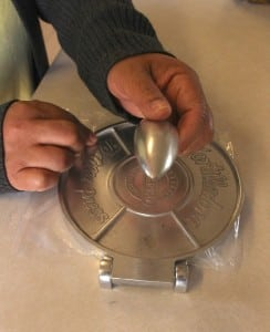 Eva Rojas uses a tortilla press in her Cold Spring kitchen.