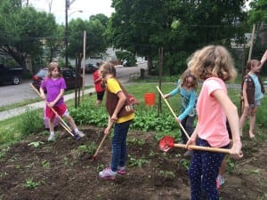 Members of Brownie Troop 1605 are seen here planting the Inspiration Garden for the Philipstown Food Pantry; the garden and food pantry are located at First Presbyterian Church, 10 Academy Street in Cold Spring. (Photo by Jennifer Gilleo)