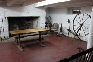 A large colonial kitchen, replete with hearth and spinning wheel, at Mount Gulian