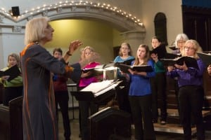 Clara Longstretch conducts members of the New Amsterdam Singers.