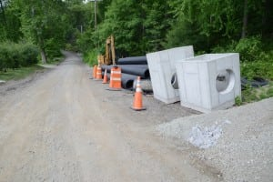 Pipes and equipment wait near the anticipated site of South Mountain Road drainage work.
