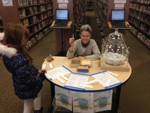 Time Capsule creator Jill Reynolds solicited messages from all over Beacon over a course of months; here she is pictured at Howland Library, where the capsule will reside until 2163, when it is opened.