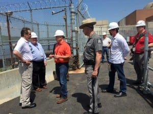 Gov. Cuomo  (left) is briefed by NYSDEC Commissioner Joseph Martens at Indian Point after the May 9 incident (official photo).