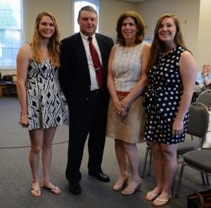 Robert Flaherty with (from left) daughter Kelsey, wife Annette, and daughter Rachel.