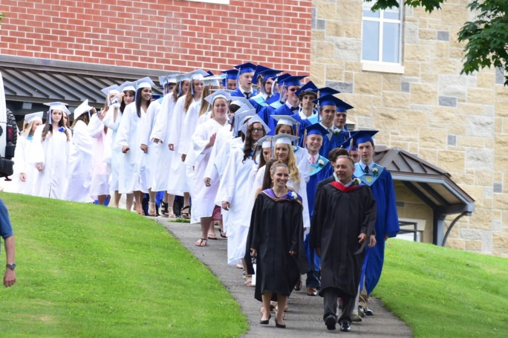 Ceremonies began with the graduates-elect making the walk down from the high school for the last time. Photo by M. Turton
