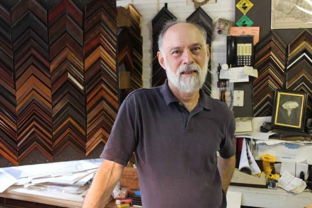 Hudson Rogue's proprietor, Richard Saunders, is framed by his frame collection.