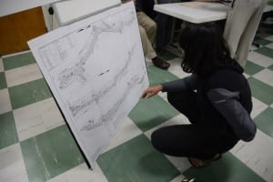 A resident studies charts of the planned drainage work.