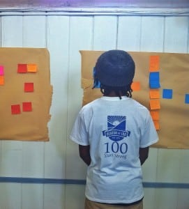 A member of I Am Beacon reads some of the responses from the Beacon Speaks Out workshop. (Photo by B. Cronin)